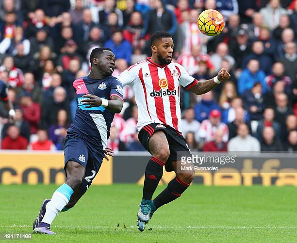Jeremain Lens of Sunderland and Cheik Ismael Tiote of Newcastle United compete for the ball during the Barclays Premier League match between...