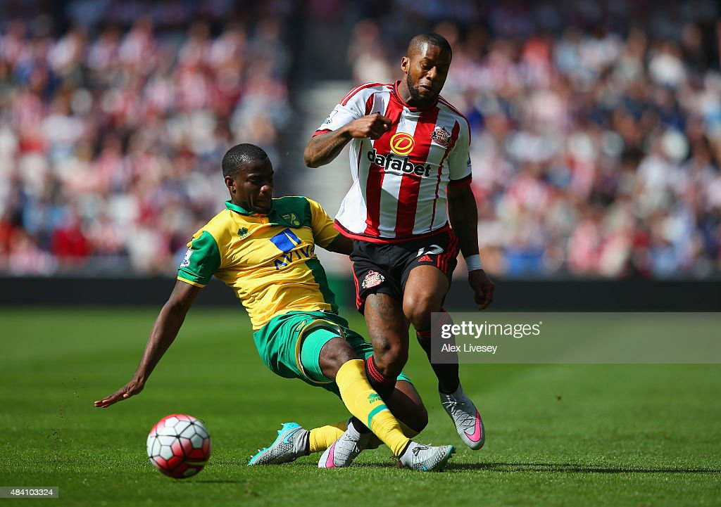 Jeremain Lens of Sunderland and Sebastien Bassong of Norwich City compete for the ball during the Barclays Premier League match between Sunderland...