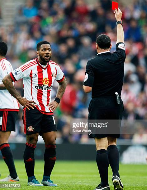 Jeremain Lens of Sunderland is shown a red card by referee Neil Swarbrick during the Barclays Premier League match between Sunderland and West Ham...