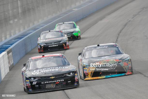 Jeremey Clements driver of the Reparablevariablescom Chevrolet and Corey LaJoie driver of the Youtheory Toyota go around turn side by side during the...