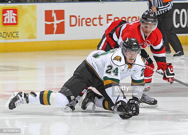 Jeremiah Addison of the Ottawa 67's battles against Michael McCarron of the London Knights in an OHL game at the Budweiser Gardens on October 24 2014...