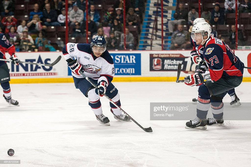 Jeremiah Addison #28 of the Saginaw Spirit skates against Remy Gitfopoulos #28 of the Windsor Spitfires on March 6, 2014 at the WFCU Centre in Windsor, Ontario, Canada.
