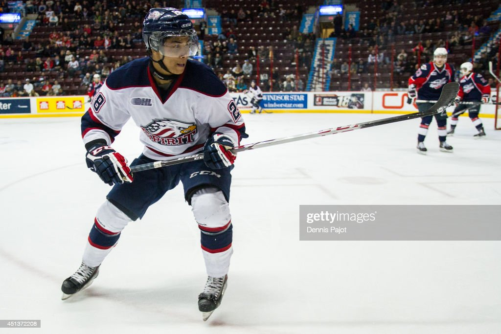 Jeremiah Addison #28 of the Saginaw Spirit skates against the Windsor Spitfires on March 6, 2014 at the WFCU Centre in Windsor, Ontario, Canada.