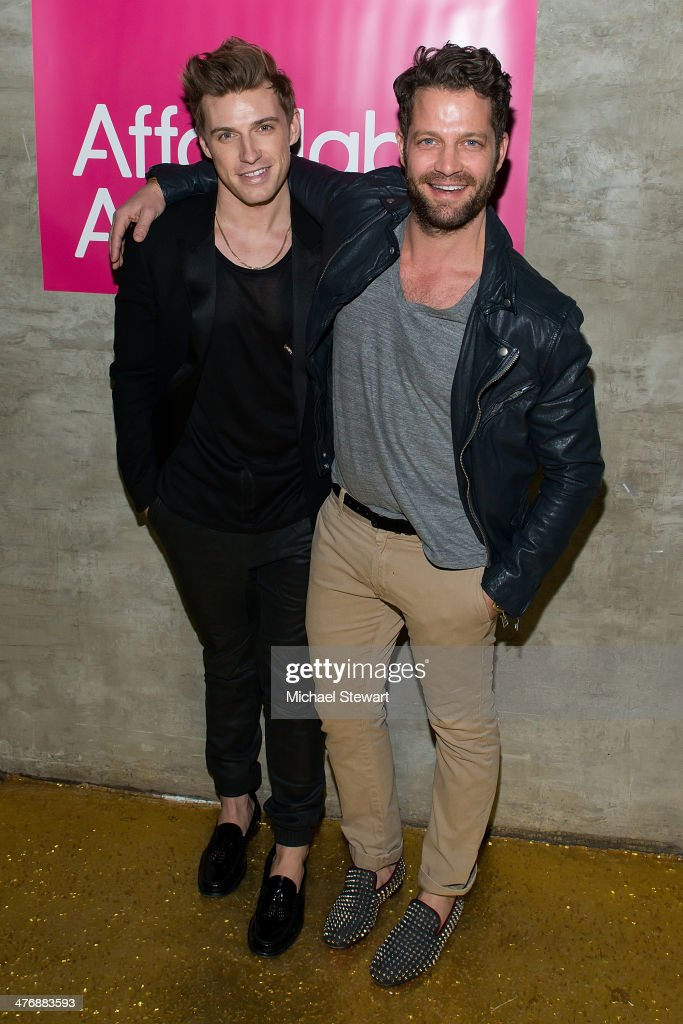Jeremiah Brent (L) and designer Nate Berkus attend the 15th Affordable Art Fair at Gilded Lily on March 5, 2014 in New York City.