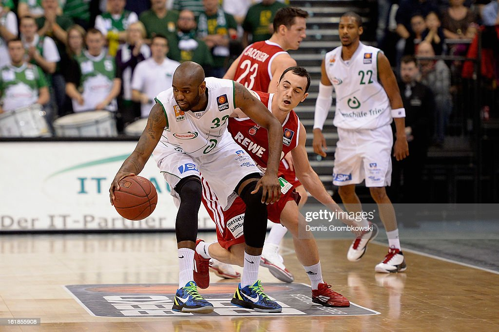 Jeremiah Bucknor of Trier and Karsten Tadda of Brose Baskets battle for the ball during the Beko BBL Basketball Bundesliga match between TBB Trier and Brose Baskets on February 17, 2013 in Trier, Germany.