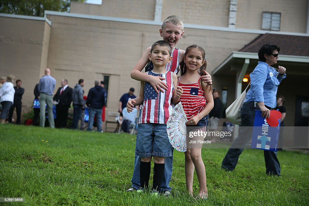 Jeremiah Gohres (rear), Logan Littlejohn and Zehayva Littlejohn (R) wait for the arrival of Democratic presidential candidate Hillary Clinton at her campaign stop at the Douglass Park Gynasium on May 1, 2016 in Indianapolis, Indiana. Presidential candidates continue to campaign across the state leading up to Indiana's primary day on May 3.