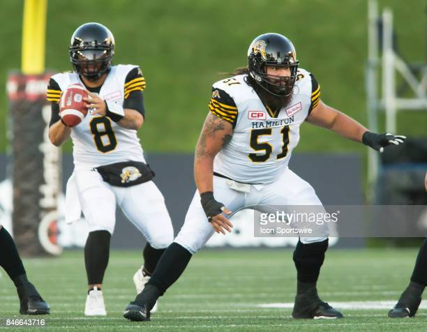 Jeremiah Masoli at quarterback and centre Mike Filer of the Hamilton TigerCats in Canadian Football League Action at TD Place Stadium in Ottawa...