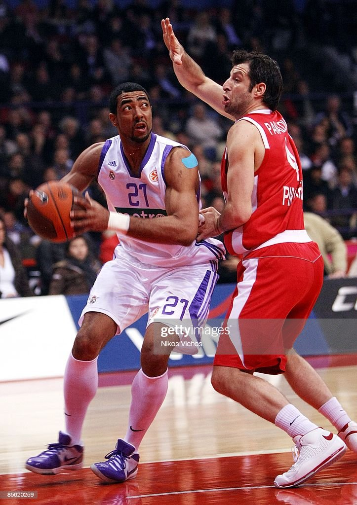Jeremiah Massey #21 of Real Madrid competes with Theo Papaloukas #4 of Olympiacos during the Play off Game 2 Olympiacos Piraeus v Real Madrid on...