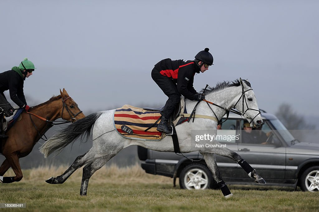 Jeremiah McGrath riding Simonsig make their way along the gallop as trainer Nicky Henderson travels alongside in his vehicle on Lambourn gallops on March 04, 2013 in Lambourn, England.