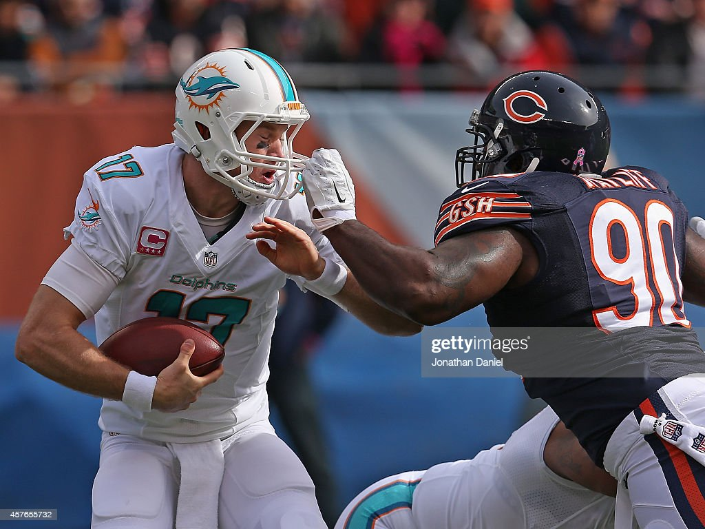 Jeremiah Ratliff #90 of the Chicago Bears sacks Ryan Tannehill #17 of the Miami Dolphins at Soldier Field on October 19, 2014 in Chicago, Illinois. The Dolphins defeated the Bears 27-14.