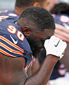 Jeremiah Ratliff of the Chicago Bears sits on the bench near the end of a game against the Miami Dolphins at Soldier Field on October 19 2014 in...