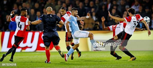 Jeremiah st Juste of Feyenoord referee Szymon Marzinak Soften Amrabat of Feyenoord Sergio Aguero of Manchester City Miguel Nelom of Feyenoord Eric...