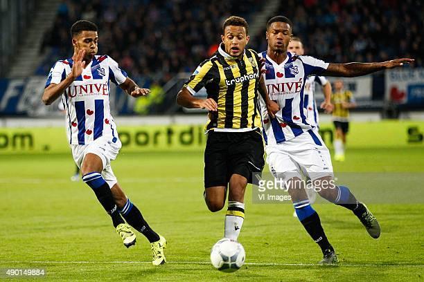 Jeremiah St Juste of sc Heerenveen Lewis Baker of Vitesse Kenneth Otigba of sc Heerenveen during the Dutch Eredivisie match between sc Heerenveen and...