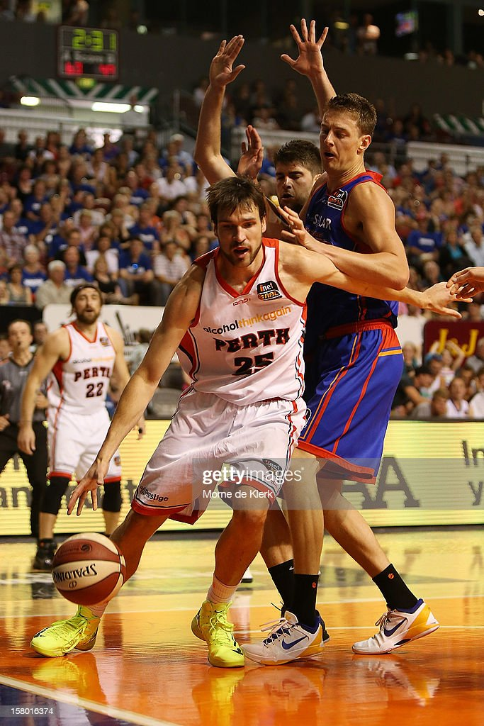 Jeremiah Trueman of Perth under pressure from Daniel Johnson of Adelaide during the round ten NBL match between the Adelaide 36ers and the Perth Wildcats at Adelaide Arena on December 9, 2012 in Adelaide, Australia.