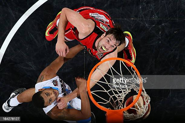 Jeremiah Trueman of the Wildcats and Corey Webster of the Breakers contest for a rebound during the round 24 NBL match between the Perth Wildcats and...