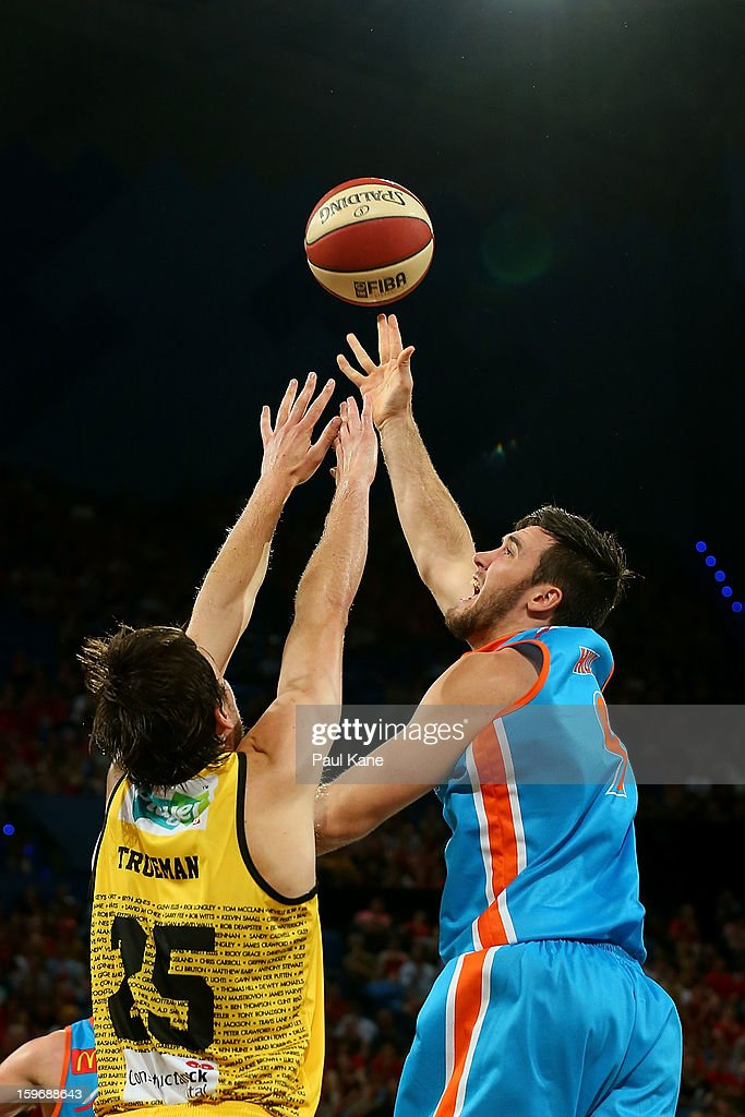 Jeremiah Trueman of the Wildcats atempts to block a shot by Brad Hill of the Taipans during the round 15 NBL match between the Perth Wildcats and the Cairns Taipans at Perth Arena on January 18, 2013 in Perth, Australia.
