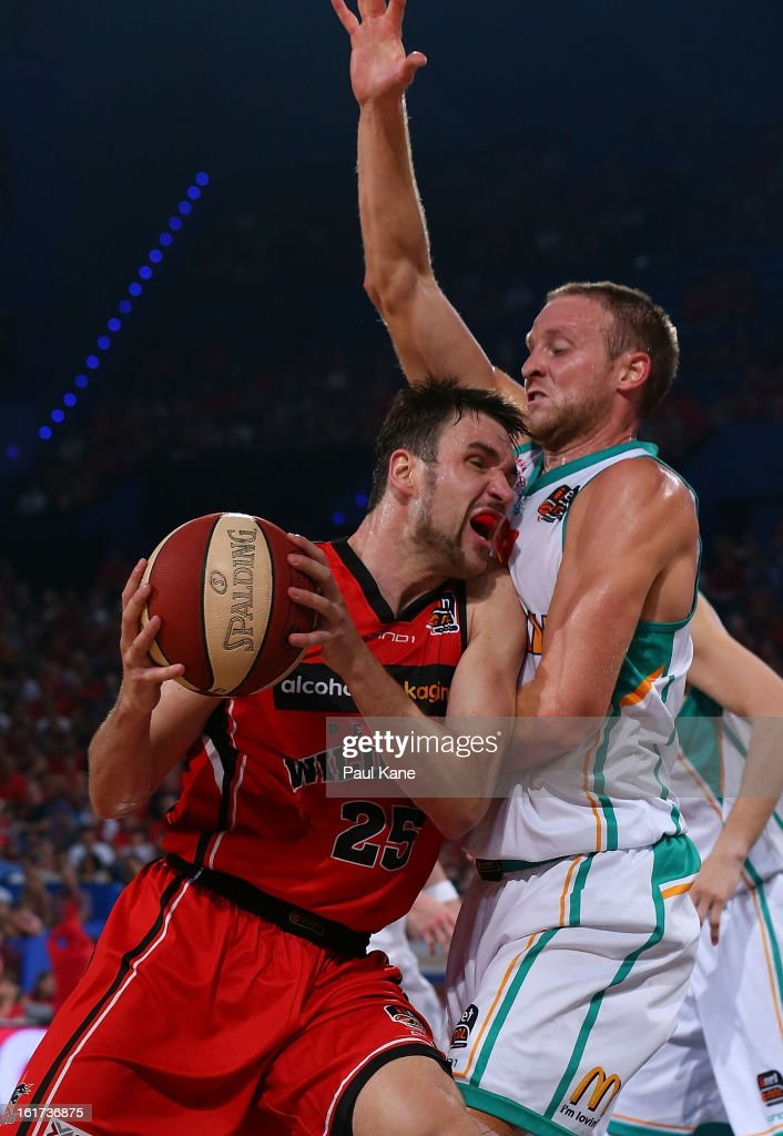 Jeremiah Trueman of the Wildcats drives to the basket against Jacob Holmes of the Crocodiles during the round 19 NBL match between the Perth Wildcats and the Townsville Crocodiles at Perth Arena on February 15, 2013 in Perth, Australia.