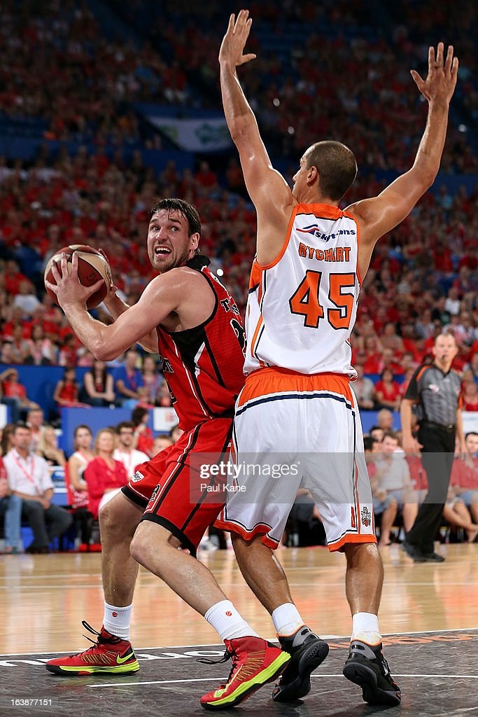 Jeremiah Trueman of the Wildcats looks to shoot against Dusty Rychart of the Taipans during the round 23 NBL match between the Perth Wildcats and the Cairns Taipans at Perth Arena on March 17, 2013 in Perth, Australia.