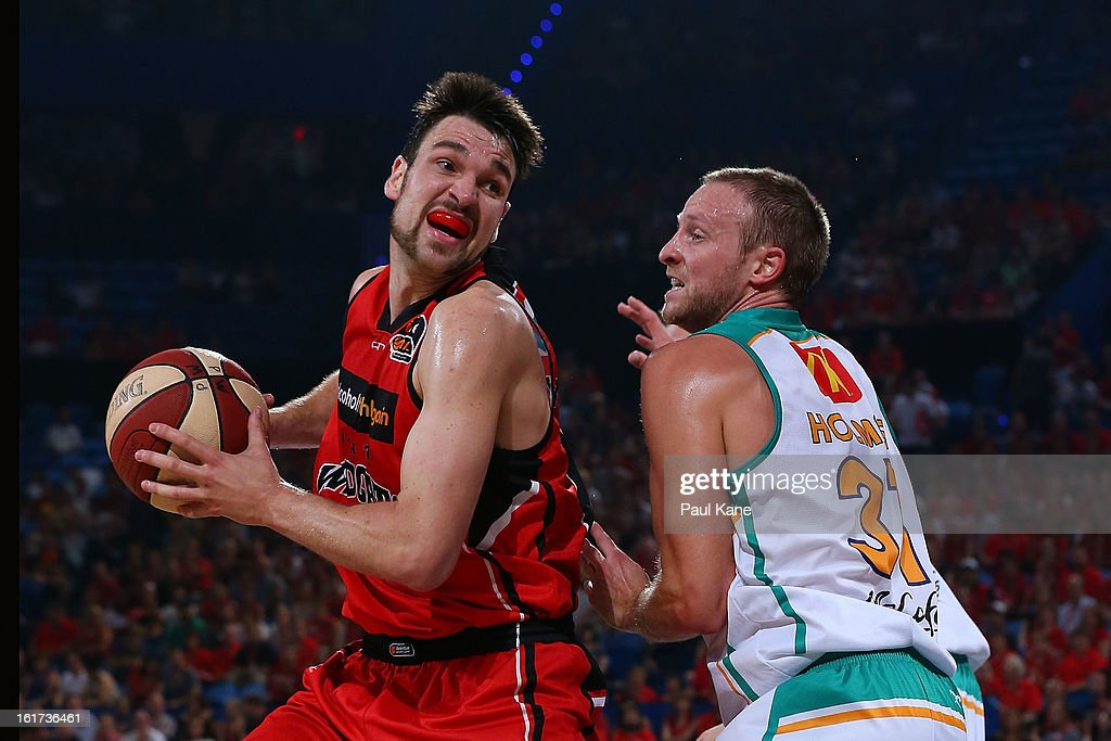 Jeremiah Trueman of the Wildcats looks to step around Jacob Holmes of the Crocodiles during the round 19 NBL match between the Perth Wildcats and the Townsville Crocodiles at Perth Arena on February 15, 2013 in Perth, Australia.