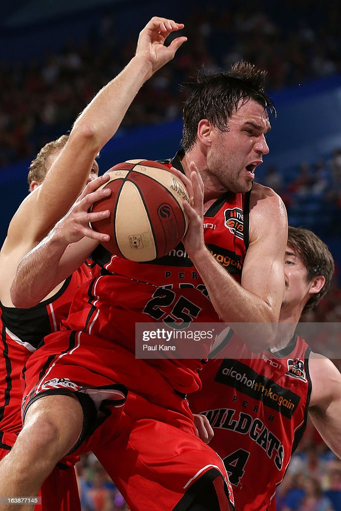 Jeremiah Trueman of the Wildcats pulls down a rebound during the round 23 NBL match between the Perth Wildcats and the Cairns Taipans at Perth Arena on March 17, 2013 in Perth, Australia.