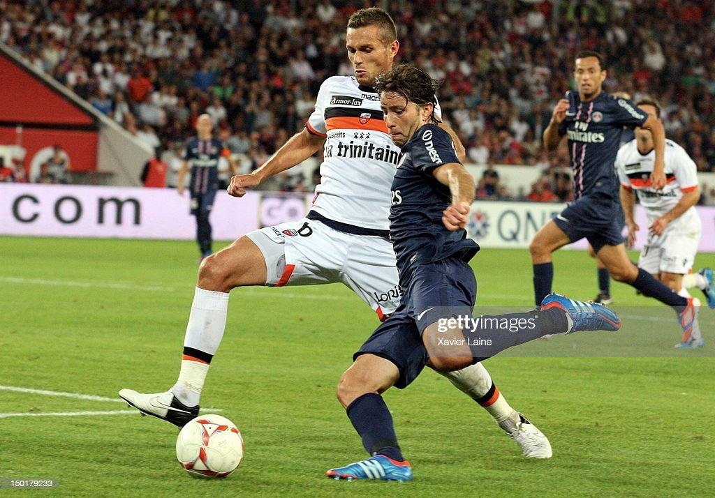 Jeremie Aliadiere of Lorient FC and Maxwell of Paris Saint-Germain during the French Ligue 1 between Paris Saint Germain and Lorient FC at Parc Des Princes on August 11, 2012 in Paris, France.