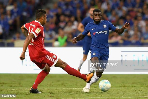 Jeremie Boga of Chelsea attempts to get past Corentin Tolisso of Bayern Muenchen during the International Champions Cup match between Chelsea FC and...