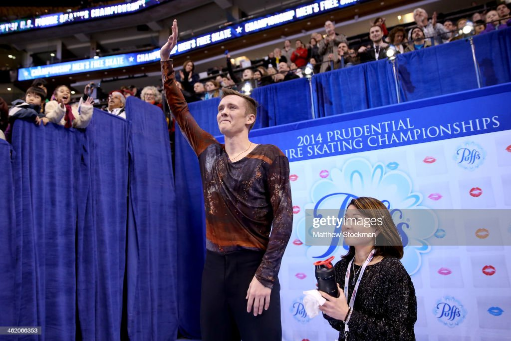<a gi-track='captionPersonalityLinkClicked' href=/galleries/search?phrase=Jeremy+Abbott&family=editorial&specificpeople=4125520 ng-click='$event.stopPropagation()'>Jeremy Abbott</a>, with his coach Yuka Sato, celebrates in the kiss and cry after skating in the free skate during the Prudential U.S. Figure Skating Championships at TD Garden on January 12, 2014 in Boston, Massachusetts.
