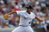 Jeremy Affeldt of the Colorado Rockies pitches against the Arizona Diamondbacks during Opening Day at Coors Field on April 2 2007 in Denver Colorado...