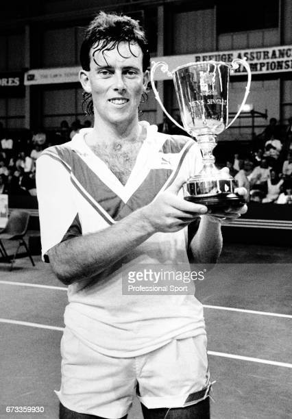 Jeremy Bates of Great Britain holding the trophy after his victory in the Refuge Assurance British Tennis Championships circa 1985