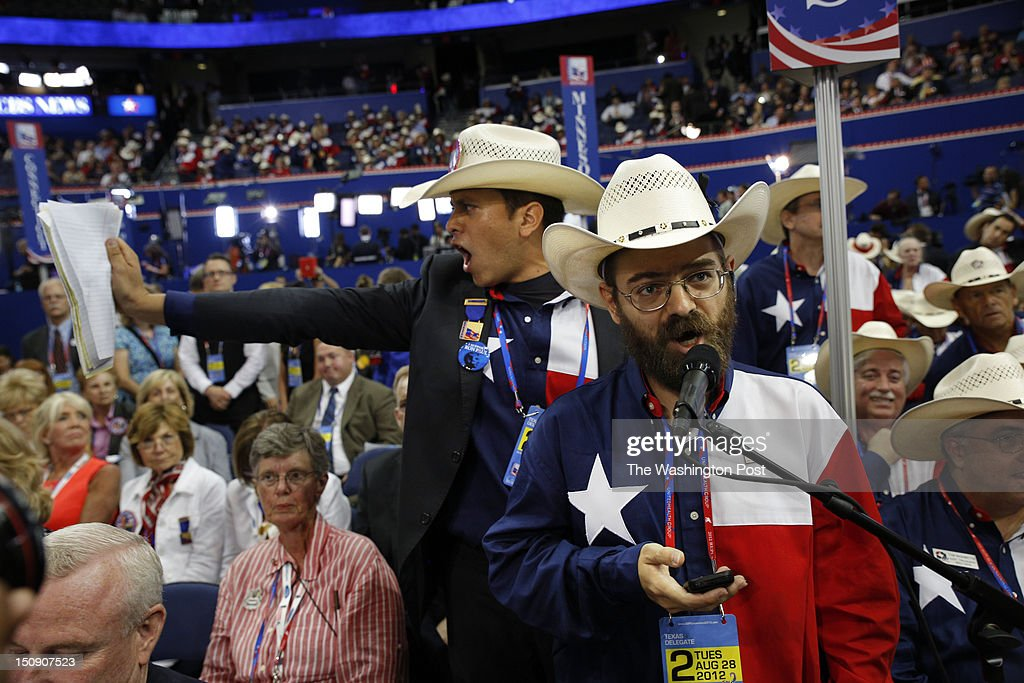 Jeremy Blosser (left) shouts 'Out of Order, Out of Order' as Luis Larotta (behind him) shows the rules as they attempt to disrupt roll call because Ron Paul delegates were not seated during the 2012 Republican National Convention at the Tampa Bay Times Forum on Tuesday, August 28, 2012. On the right is Texas delegate Lucas Thomas, who was not thrilled with the ruckus.