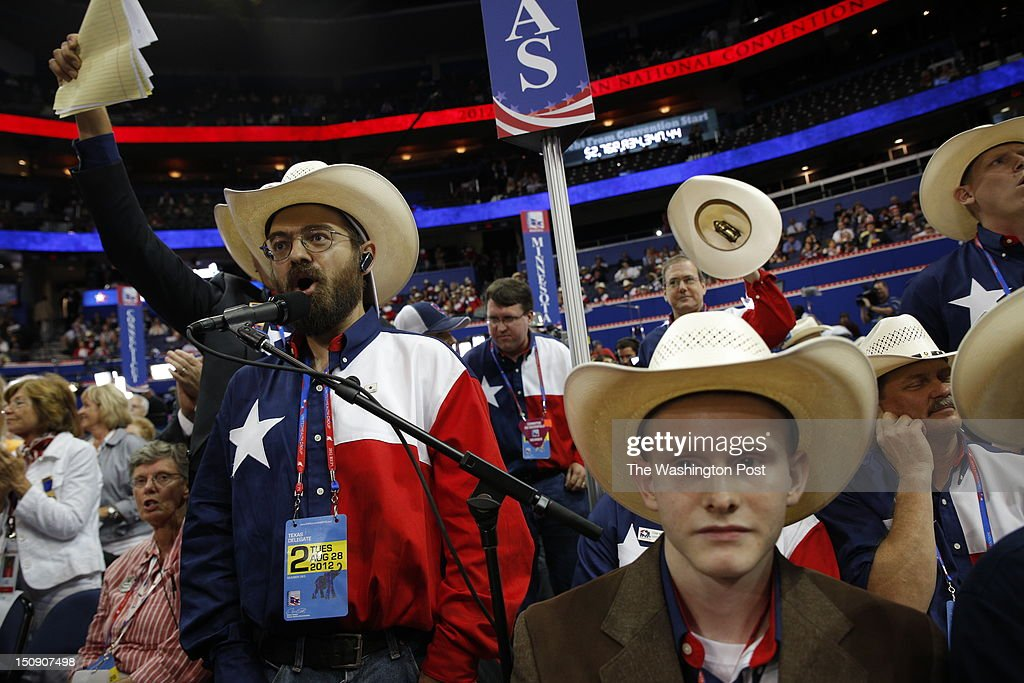 Jeremy Blosser (left) shouts 'Out of Order, Out of Order' in an attempt to disrupt roll call as Ron Paul delegates were not seated during the 2012 Republican National Convention at the Tampa Bay Times Forum on Tuesday, August 28, 2012. On the right is Texas delegate Lucas Thomas, who was not thrilled with the ruckus.