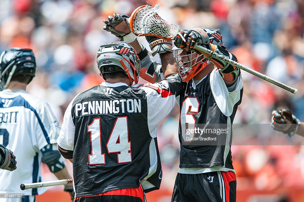 Jeremy Boltus #6 of the Denver Outlaws (right) congratulates Justin Pennington #14 on a second half goal against the Chesapeake Bayhawks during a Major League Lacrosse game at Sports Authority Field at Mile High on July 27, 2013 in Denver, Colorado. The Outlaws beat the Bayhawks 14-12.