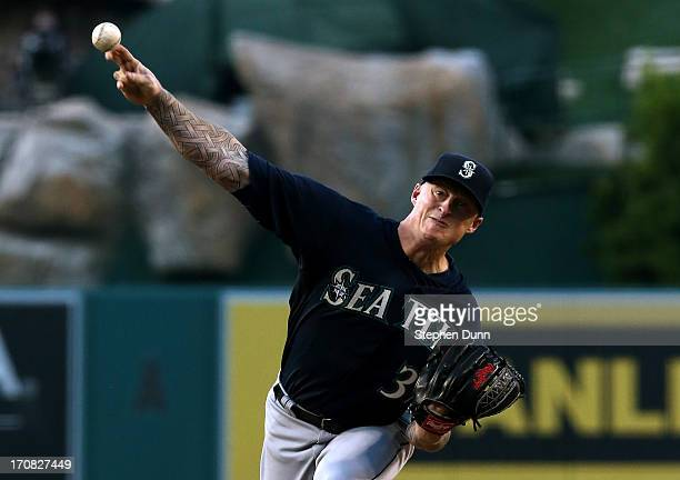 Jeremy Bonderman of the Seattle Mariners throws a pitch against the Los Angeles Angels of Anaheim at Angel Stadium of Anaheim on June 18 2013 in...