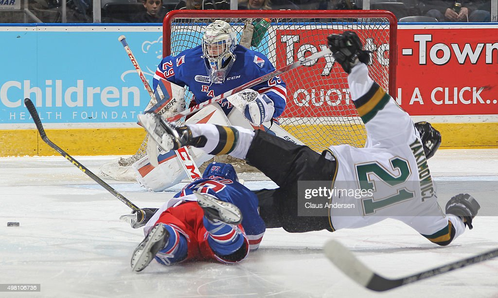 Jeremy Bracco of the Kitchener Rangers takes down Chandler Yakimowicz of the London Knights thus drawing a penalty shot during an OHL game at...