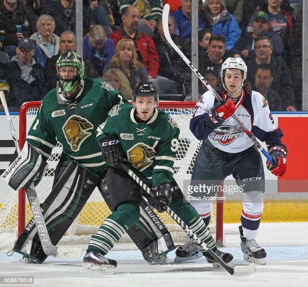 Jeremy Bracco of the Windsor Spitfires looks for a shot to tip against Tyler Parsons and Victor Mete of the London Knights during Game Two of the OHL...