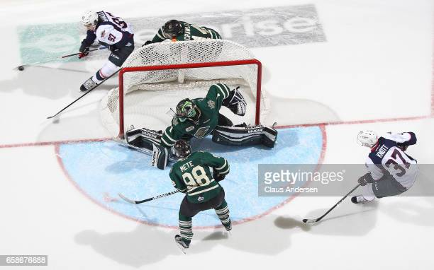 Jeremy Bracco of the Windsor Spitfires skates around the net for a scoring attempt on Tyler Parsons of the London Knights during Game Two of the OHL...