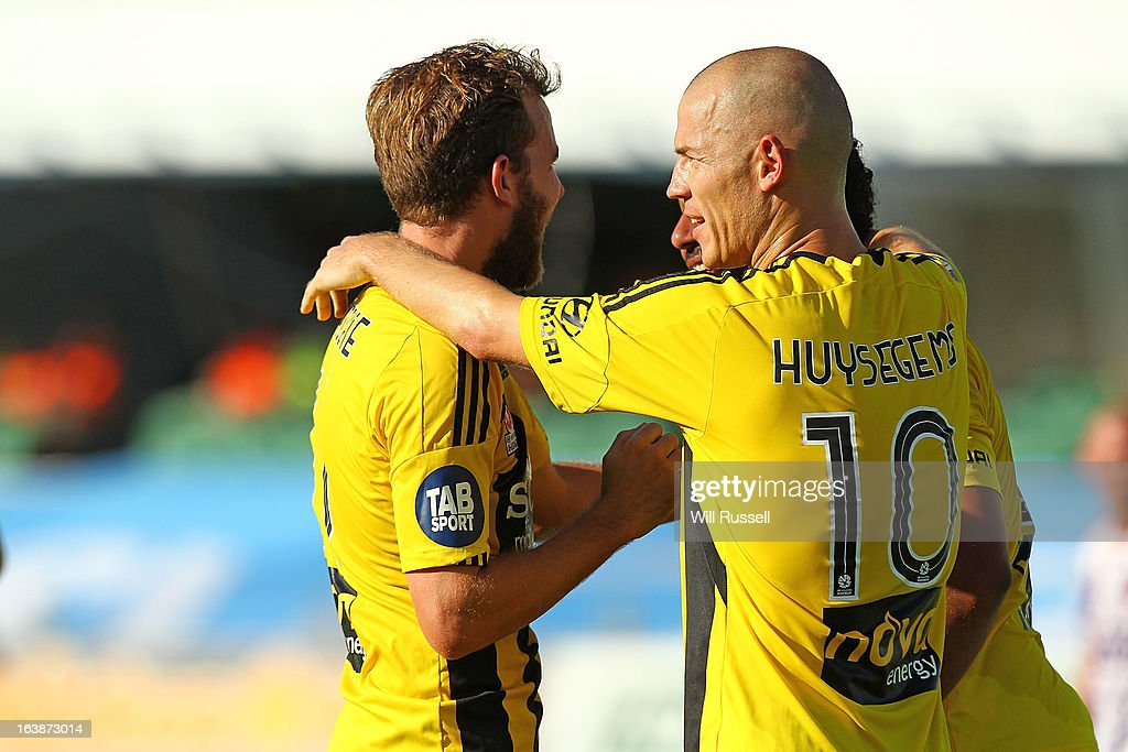 Jeremy Brockie and Stein Huysegems congratulate team-mate Paul Ifill after scoring a goal during the round 25 A-League match between the Perth Glory and the Wellington Phoenix at nib Stadium on March 17, 2013 in Perth, Australia.