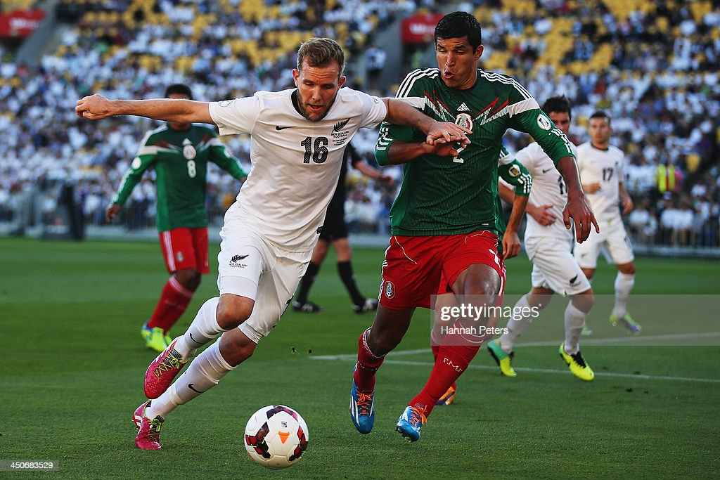 <a gi-track='captionPersonalityLinkClicked' href=/galleries/search?phrase=Jeremy+Brockie&family=editorial&specificpeople=591299 ng-click='$event.stopPropagation()'>Jeremy Brockie</a> of New Zealand competes with Francisco Javier Rodriguez of Mexico for the ball during leg 2 of the FIFA World Cup Qualifier match between the New Zealand All Whites and Mexico at Westpac Stadium on November 20, 2013 in Wellington, New Zealand.