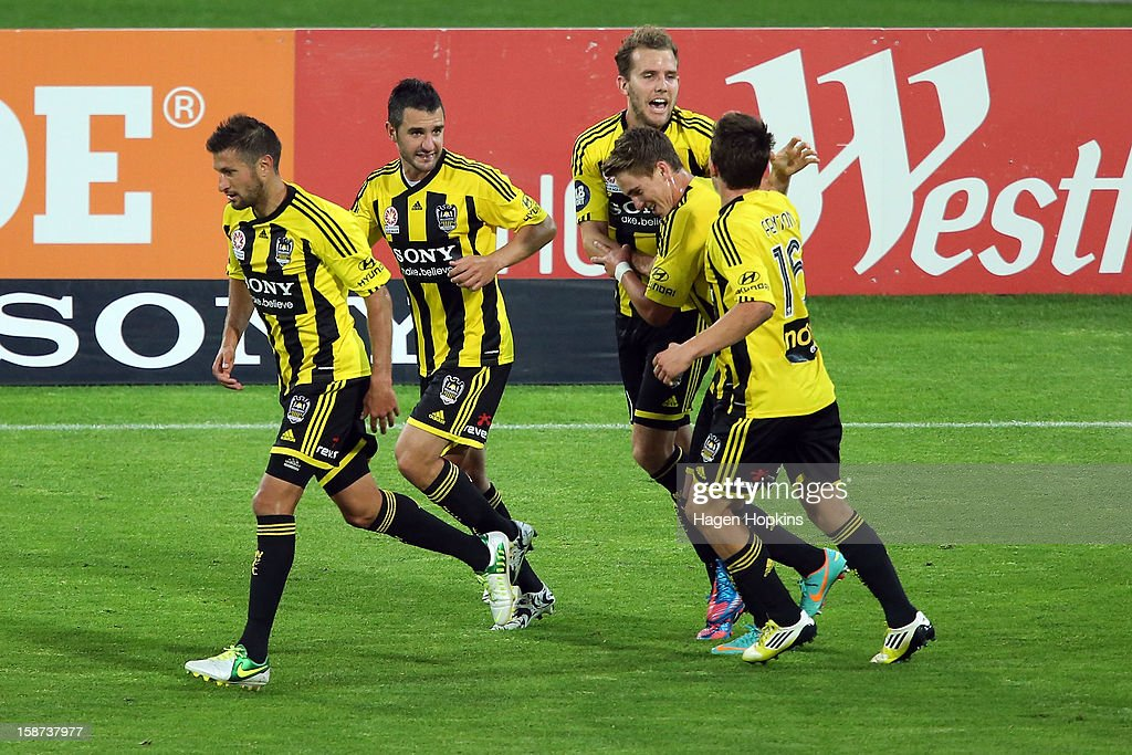 <a gi-track='captionPersonalityLinkClicked' href=/galleries/search?phrase=Jeremy+Brockie&family=editorial&specificpeople=591299 ng-click='$event.stopPropagation()'>Jeremy Brockie</a> of the Phoenix celebrates his goal with teammates during the round 13 A-League match between the Wellington Phoenix and the Melbourne Heart at Westpac Stadium on December 27, 2012 in Wellington, New Zealand.