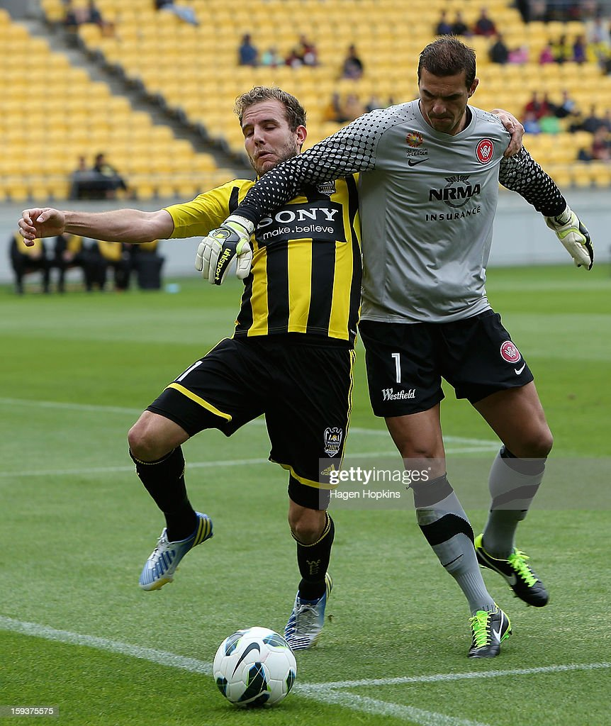 Jeremy Brockie of the Phoenix challenges for the ball with Ante Covic of the Wanderers during the round 16 A-League match between the Wellington Phoenix and the Western Sydney Wanderers at Westpac Stadium on January 13, 2013 in Wellington, New Zealand.