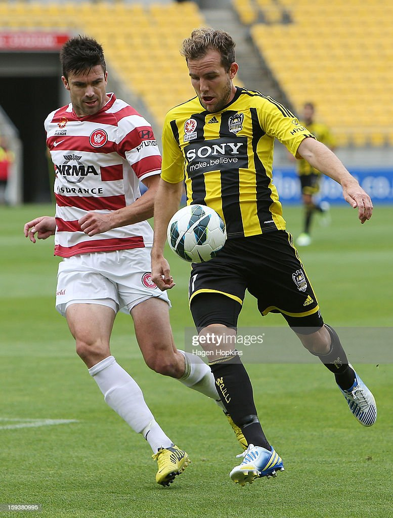 Jeremy Brockie of the Phoenix controls the ball under pressure from Michael Beauchamp of the Wanderers during the round 16 A-League match between the Wellington Phoenix and the Western Sydney Wanderers at Westpac Stadium on January 13, 2013 in Wellington, New Zealand.