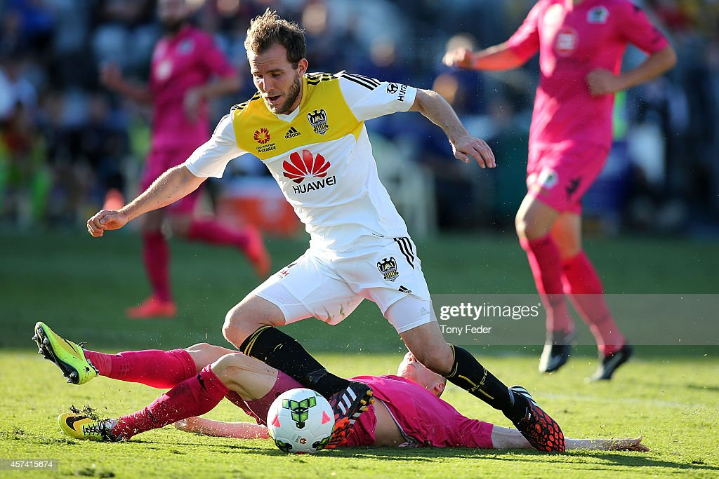 <a gi-track='captionPersonalityLinkClicked' href=/galleries/search?phrase=Jeremy+Brockie&family=editorial&specificpeople=591299 ng-click='$event.stopPropagation()'>Jeremy Brockie</a> of the Phoenix is brought down in the penalty box by Jacob Poscoliero of the Mariners during the round two A-League match between the Central Coast Mariners and the Wellington Phoenix at Central Coast Stadium on October 18, 2014 in Gosford, Australia.