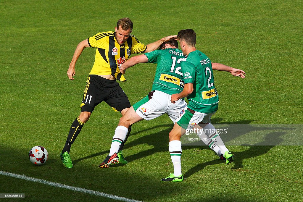 Jeremy Brockie of the Phoenix is challenged by Connor Chapman and Scott Neville of the Jets during the round three A-League match between Wellington Phoenix and the Newcastle Jets at McLean Park on October 27, 2013 in Napier, New Zealand.