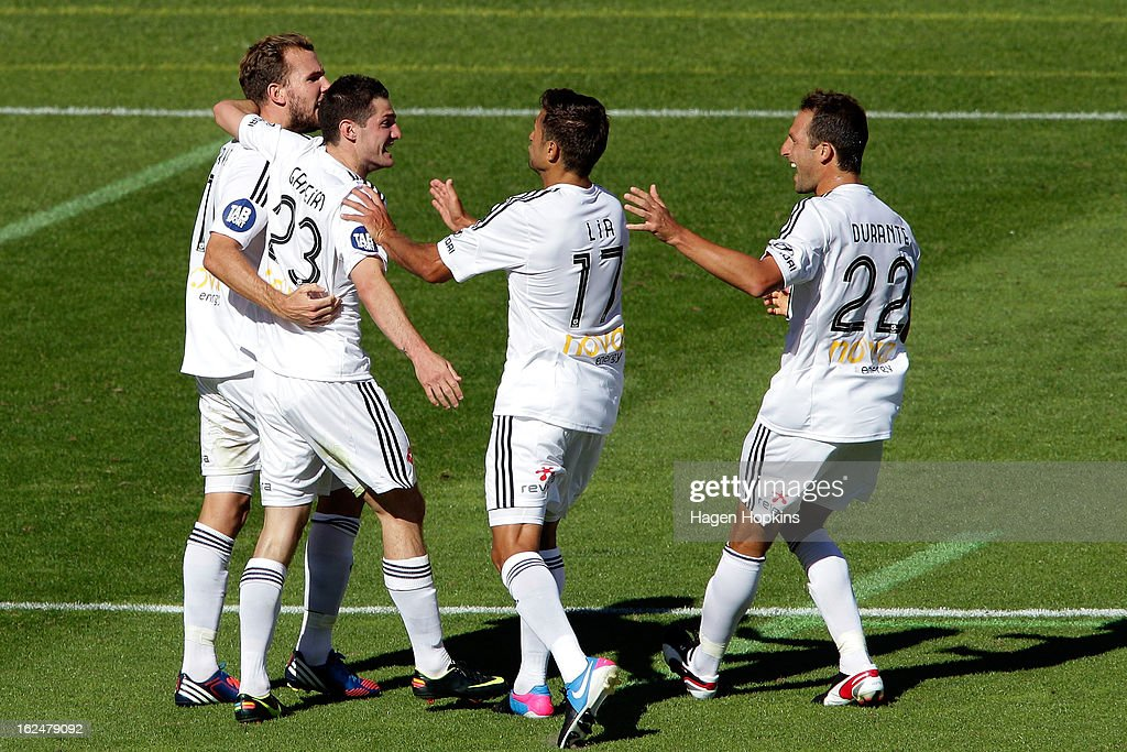 Jeremy Brockie (L) of the Phoenix is congratulated on his goal by teammates Corey Gameiro, Vince Lia and Andrew Durante during the round 22 A-League match between the Wellington Phoenix and Adelaide United at Westpac Stadium on February 24, 2013 in Wellington, New Zealand.