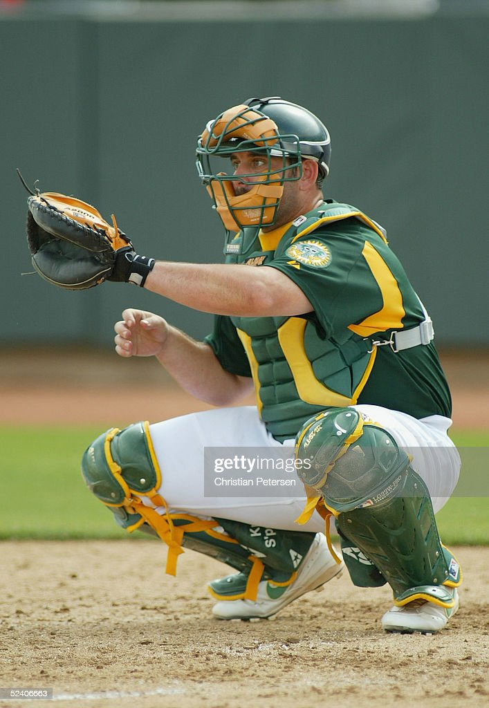 Jeremy Brown #5 of the Oakland Athletics catches during the MLB spring training game against the Chicago Cubs at Phoenix Municipal Stadium on March 3, 2005 in Phoenix, Arizona. The Cubs defeated the A's 2-1.