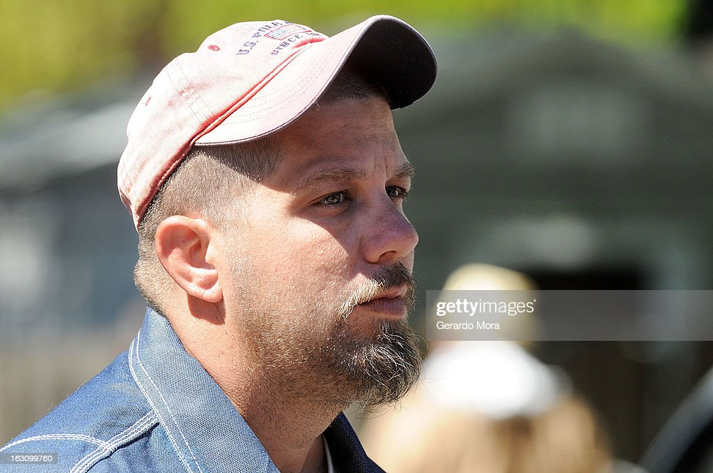 Jeremy Bush, brother of Jeffrey Bush who was swallowed by sinkhole, speaks with media on March 4, 2013 in Seffner, Florida. Jeff Bush, presumed dead after a sinkhole, estimated at 60 feet deep, opened under his bedroom while he was sleeping in the home. Demolition crews are working to raze the house, recover possessions, and stabilize the now-shaky ground.