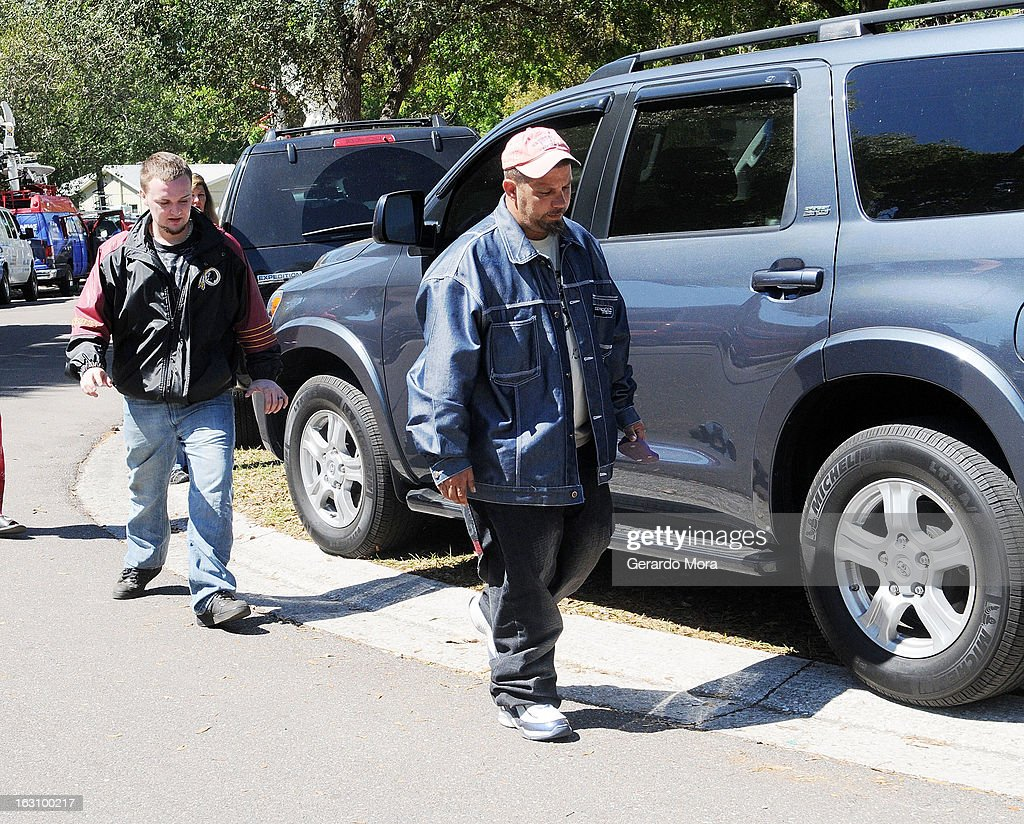 Jeremy Bush (R), brother of Jeffrey Bush who was swallowed by sinkhole, leaves the neighborhood after observing the house demolished on March 4, 2013 in Seffner, Florida. Jeff Bush, presumed dead after a sinkhole, estimated at 60 feet deep, opened under his bedroom while he was sleeping in the home. Demolition crews are working to raze the house, recover possessions, and stabilize the now-shaky ground.