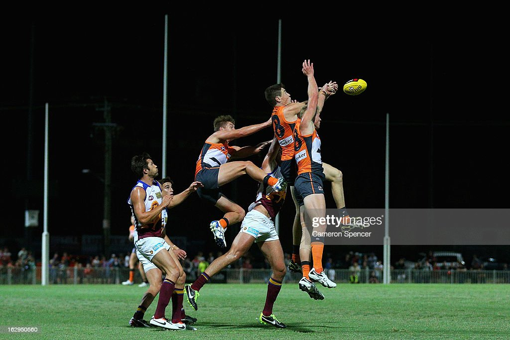 Jeremy Cameron of the Giants (C) and team mates attempt to mark the ball during the round two AFL NAB Cup match between the Greater Western Sydney Giants and the Brisbane Lions at the Robertson Oval in Wagga Wagga, Australia.
