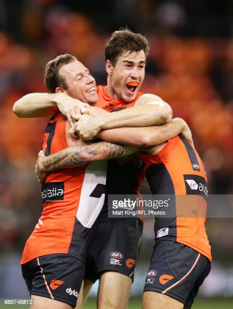 Jeremy Cameron of the Giants celebrates victory with Steve Johnson of the Giants at fulltime during the round nine AFL match between the Greater...