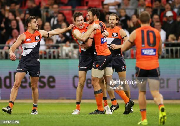 Jeremy Cameron of the Giants celebrates with team mates after kicking a goal during the round eight AFL match between the Greater Western Sydney...